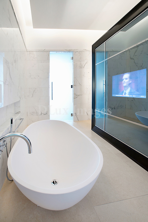 Bright white bathroom with marble walls