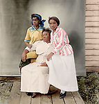 """At left is Florence Jones; at right is probably Elenora """"Kit"""" Carriger (later Evans). The older woman may be Kit's mother, Alice. Kit Carriger (1893-1981) married George Evans (1874-1945) around 1919. They were very active in Newman Methodist Episcopal Church. George was a charter member of Lincoln's black Masonic lodge and worked for many years as a chauffeur and houseman for C. B. Towle, a manufacturer. Widowed for 36 years, Kit cooked for a fraternity."""