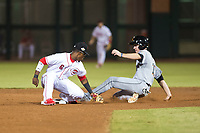 Scottsdale Scorpions second baseman Shed Long (6), of the Cincinnati Reds organization, applies the tag to Brian Miller (10), of the Miami Marlins organization, as he slides into second base on a stolen base attempt during an Arizona Fall League game against the Salt River Rafters at Scottsdale Stadium on October 12, 2018 in Scottsdale, Arizona. Scottsdale defeated Salt River 6-2. (Zachary Lucy/Four Seam Images)