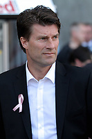 Saturday, 06 October 2012<br /> Pictured: Swansea manager Michael Laudrup with a pink ribbon for missing five year old April Jones of Machynlleth.<br /> Re: Barclays Premier League, Swansea City FC v Reading at the Liberty Stadium, south Wales.