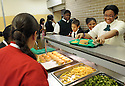 Students at New Orleans College Prep School are served a healthy cooked meal prepared by Liberty Kitchen, a training program for at-risk youths, in New Orleans, Thurs., March 22, 2012.