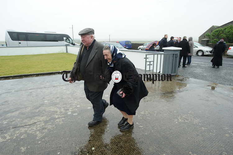 Locals P and Mary Roche head into mass ahead of the visit of the Taoiseach to Loop Head to launch the Fine Gael tourism initiative. Photograph by John Kelly.