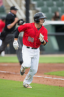 Brett Austin (20) of the Kannapolis Intimidators hustles down the first base line against the Hickory Crawdads at CMC-Northeast Stadium on April 17, 2015 in Kannapolis, North Carolina.  The Crawdads defeated the Intimidators 9-5 in game one of a double-header.  (Brian Westerholt/Four Seam Images)