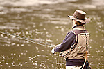 A woman is fly fishing on the Madison River in Yellowstone National Park.