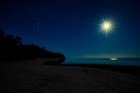 Full moon at Amuri Beach, Aitutaki Island, Cook Islands.