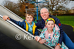 Michael Cotter Snr with his children Michael Jr and Marie enjoying the playground in the Tralee town park on Saturday.