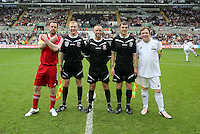 Pictured: Referees with team captains Danny Dyer (L) and Adam Woodyatt (R). Sunday, 01 June 2014<br /> Re: Celebrities v Celebrities football game organised by Sellebrity Scoccer, in aid of Swansea City Community Trust, at the Liberty Stadium, south Wales.