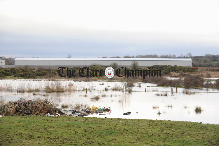 Flood waters cover the site of the proposed new Cusack Park Stadium off the Quin road in Ennis. Photograph by John Kelly.