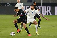 Zweikampf Jamal Musiala (Deutschland Germany) gegen Victor Palsson (Island Iceland) - 25.03.2021: WM-Qualifikationsspiel Deutschland gegen Island, Schauinsland Arena Duisburg
