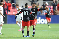 WASHINTON, DC - FEBRUARY 29: Washington, D.C. - February 29, 2020: Edison Flores #10 of D.C. United with Ola Kamara #9 of D.C. United during a game between D.C. United and Colorado Rapids. The Colorado Rapids defeated D.C. United 2-1 during their Major League Soccer (MLS)  match at Audi Field during a game between Colorado Rapids and D.C. United at Audi FIeld on February 29, 2020 in Washinton, DC.
