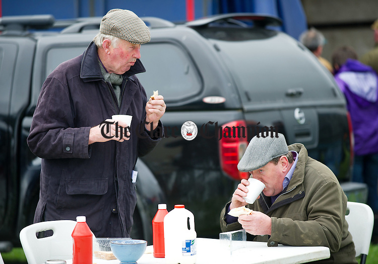 David Dwane and Dick Philpott of Kanturk  take a break during the County Clare Hunt point to point at Quakerstown. Photograph by John Kelly.