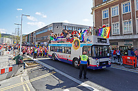 Pictured: The parade bus travels through the Kingsway. Saturday 04 May 2019<br /> Re: Swansea Pride Parade in south Wales, UK.