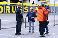 16th May 2020, Signal Iduna Park, Dortmund, Germany; Bundesliga football, Borussia Dortmund versus FC Schalke;   RTL reporter Ulrich Klose in interview with a police officer