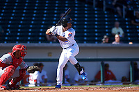 Mesa Solar Sox right fielder Charcer Burks (1), of the Chicago Cubs organization, at bat in front of catcher Edgar Cabral (30) during an Arizona Fall League game against the Glendale Desert Dogs on October 28, 2017 at Sloan Park in Mesa, Arizona. The Solar Sox defeated the Desert Dogs 9-6. (Zachary Lucy/Four Seam Images)