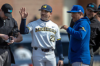 Michigan Wolverines head coach Erik Bakich (23) talks with San Jose State head coach Brad SanFilippo on March 27, 2019 before Game 1 of the NCAA baseball doubleheader at Ray Fisher Stadium in Ann Arbor, Michigan. Michigan defeated San Jose State 1-0. (Andrew Woolley/Four Seam Images)