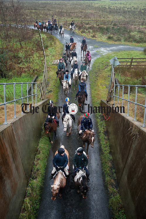 The children's hunt organised by The Clare Hunt at Newmarket On Fergus about to go pass under the M18 motorway. Photograph by John Kelly.