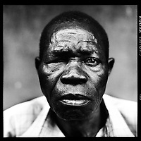 Jerome Baonga: 'We hid in the bush for six days. That was June 2003. The Ugandans and Rwandans felt they had to fight their war here. Fighting went on day and night. Many dead soldiers were lying rotting on the street when we came back to our district, on the left bank of the Congo River. My little nephew was shot when he went to fetch food in the village. The start of the Mobutu period was good, but after ten years the gloss had worn off again. Under Father Kabila, it was a little paradise here. When we heard the news on Radio Français International that our President had been murdered in Kinshasa, people died of sorrow here.'..