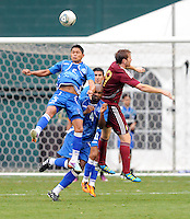 El Salvador defender Victor Turcios (5) heads the ball against Venezuela forward Fernando Aristeguieta (9). El Salvador National Team defeated Venezuela 3-2 in an international friendly at RFK Stadium, Sunday August 7, 2011.