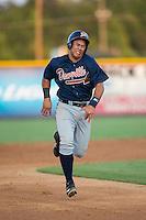 Carlos Castro (19) of the Danville Braves hustles towards third base against the Burlington Royals at Burlington Athletic Park on August 13, 2015 in Burlington, North Carolina.  The Braves defeated the Royals 6-3. (Brian Westerholt/Four Seam Images)