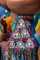 Abhaneri, Rajasthan, India.  Multicolored Sequined Headdress  of a Woman Walking to a Bride's House in a Pre-wedding Celebration.