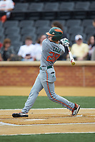 Jordan Lala (28) of the Miami Hurricanes follows through on his swing against the Wake Forest Demon Deacons at David F. Couch Ballpark on May 11, 2019 in  Winston-Salem, North Carolina. The Hurricanes defeated the Demon Deacons 8-4. (Brian Westerholt/Four Seam Images)