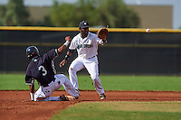 Seattle Mariners Greifer Andrade (8) stretches for a throw as Erick Mejia (3) slides back to second during an instructional league intrasquad game on October 6, 2015 at the Peoria Sports Complex in Peoria, Arizona.  (Mike Janes/Four Seam Images)