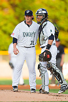 Charlotte Knights catcher Bryan Anderson (33) has a chat on the mound with starting pitcher Nick McCully (31) during the International League game against the Indianapolis Indians at Knights Stadium on July 22, 2012 in Fort Mill, South Carolina.  The Indians defeated the Knights 17-1.  (Brian Westerholt/Four Seam Images)