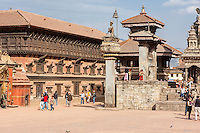 Bhaktapur, Nepal.  Durbar Square, Palace of 55 Windows on Left,  King Bhupatindra's Column in Middle, Vatsala Durga Temple, far right, on margin of photo.  The king's column remained standing during the earthquake of April 2015.  The Vatsala Durga temple was completely destroyed.