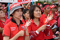 Thailand. Bangkok. Red-shirted supporters of ousted premier Thaksin Shinawatra gather outside Government House to demand the dissolution of the House of Representatives and the resignation of the Democrat led coalition. Thousand of anti-government Democratic Alliance against Dictatoship (DAAD) protesters shout slogans while demonstrating. Each day by late afternoon, the red-shirt uprising swells with thousand supporters to hear verbal attacks against the government. A new political crisis with the red power political movement.  Truth today. 29.03.09 © 2009 Didier Ruef