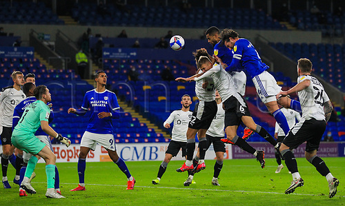 3rd November 2020; Cardiff City Stadium, Cardiff, Glamorgan, Wales; English Football League Championship Football, Cardiff City versus Barnsley; Sean Morrison of Cardiff City leaps high to head at goal