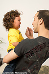 20 month old toddler boy upset, crying, talked to by father