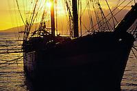 Sunset near the carthaginian historic ship with lanai island in the rear