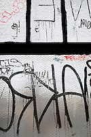 AVAILABLE FROM JEFF AS A FINE ART PRINT<br /> <br /> AVAILABLE FOR LICENSING FROM GETTY IMAGES.  Please go to www.gettyimages.com and search for image # 131288203.<br /> <br /> Detail of Graffiti on the Window of an Old Industrial Building (converted into artist's studios) in the DUMBO neighborhood of Brooklyn, New York City, New York State, USA