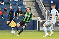 KANSAS CITY, KS - MAY 9: Jared Stroud #20 Austin FC with the ball during a game between Austin FC and Sporting Kansas City at Children's Mercy Park on May 9, 2021 in Kansas City, Kansas.