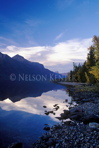 Glass smooth surface of Lake MacDonald  in Glacier National Park
