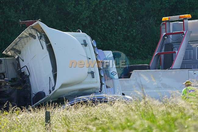 The four occupants 2 adults and 2 children had a very lucky escape when a fully laden truck carrying cement crashed over on top of there car as they came to a stop at the Platin road M1 ramp roundabout, outside Drogheda on Monday evening, All occupants and driver were taken to Our Lady of Lourdes hospital in Drogheda.<br /> <br /> Picture Fran Caffrey/Newsfile