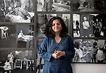 26 March 2013, Mumbai, INDIA:  Photographer Dayanita Singh with some of her photographs at her office in the New Delhi suburb of Vasant Vihar. Singh is preparing to participate in the Venice Biennial with a digital slideshow go her archive of photographs in the German Pavilion at Venice. PIcture by Graham Crouch