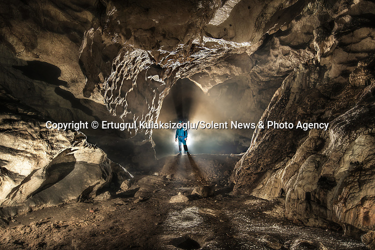 Pictured:    Inagzi Cave, Yenice, Karabük, Turkey.<br /> <br /> A team of explorers venture through a series of incredible caves filled with huge stalagmites and underwater lakes.<br /> <br /> The adventurers are carrying out tests in the subterranean world to work out how old the caves are and how they were formed.<br /> <br /> The intriguing images were captured in caves across Turkey by amateur photographer Ertuğrul Kulaksizoglu.   SEE OUR COPY FOR FULL DETAILS.<br /> <br /> <br /> Please byline: Ertugrul Kulaksizoglu/Solent News<br /> <br /> © Ertugrul Kulaksizoglu/Solent News & Photo Agency<br /> UK +44 (0) 2380 458800