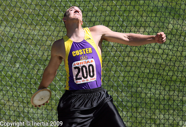 SPEARFISH, SD - May 29: Darin Smith of Custer throws the discus Friday at the Class A State Track Meet in Spearfish. (Photo by Dave Eggen/Inertia)