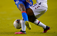 HOUSTON, TX - JANUARY 28: Crystal Dunn #19 of the United States battles with Nerilia Mondesir #10 of Haiti during a game between Haiti and USWNT at BBVA Stadium on January 28, 2020 in Houston, Texas.