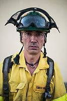 Juan Pedro. The firefighter from the BRICA Málaga 703, the Andalusian Service firefighting (INFOCA),  posses after a wildfire in Los Barrios near Cadiz on July 25, 2015. © Pedro ARMESTRE