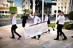 June 2013, Ramallah, West Bank. The winner team of the INJAZ program are going home with their 5000 dollar cheque. This program, financed by private Palestinian companies, intends to promote entrepreneurship amongst Palestinian youth. A competition is organized with teams of students presenting a fictional business projects. The teams are judged according to the innovativeness of their projects.