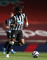 24th April 2021; Anfield, Liverpool, Merseyside, England; English Premier League Football, Liverpool versus Newcastle United; Allan Saint-Maximin of Newcastle United runs with the ball