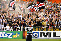 DC United forward Alecko Eskandarian saluting the fans at the end of the game. DC United defeated the New England Revolution 1-0 at RFK Stadium, Washington DC, June 3, 2006.