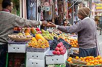 Jaipur, Rajasthan, India.  Buying Fruit at a Fruit Stand.