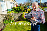 Brendan Hobbert at home with a photo of the  1956 Kerins O'Rahilly's Athletic and Cycling Club with the Quill Cup.