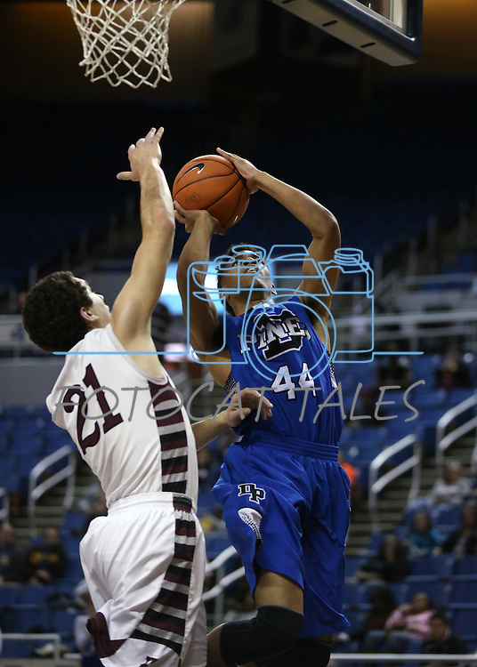 Desert Pines' Trevon Abdullah shoots past Elko defender Nathan Klekas during the NIAA basketball state tournament at Lawlor Events Center, in Reno, Nev., on Friday, Feb. 28, 2014. Elko won 63-47 to advance to the state championship game. (Cathleen Allison/Las Vegas Review-Journal)