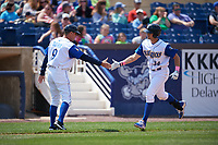 Wilmington Blue Rocks manager Jamie Quirk (9) congratulates Roman Collins (34) as he rounds the bases after hitting a home run during the first game of a doubleheader against the Frederick Keys on May 14, 2017 at Daniel S. Frawley Stadium in Wilmington, Delaware.  Wilmington defeated Frederick 10-2.  (Mike Janes/Four Seam Images)
