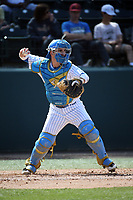Will McInerny (15) of the UCLA Bruins throws to second base during a game against the Arizona Wildcats at Jackie Robinson Stadium on March 19, 2017 in Los Angeles, California. UCLA defeated Arizona, 8-7. (Larry Goren/Four Seam Images)