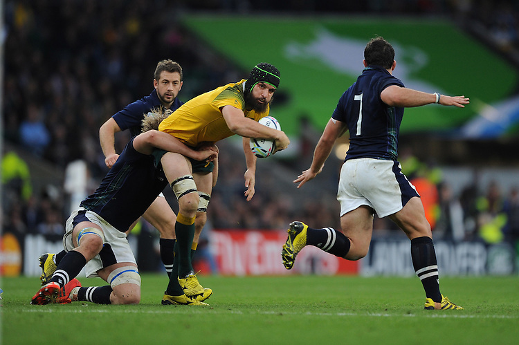 Scott Fardy of Australia looks to offload as he is tackled by Jonny Gray of Scotland during the Quarter Final of the Rugby World Cup 2015 between Australia and Scotland - 18/10/2015 - Twickenham Stadium, London<br /> Mandatory Credit: Rob Munro/Stewart Communications